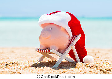 Piggy Bank With Santa Hat On The Deck Chair