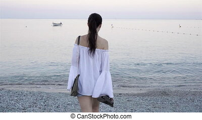 Young woman on the beach in european vacation on the Ligurian coast