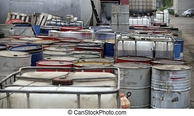 Drums with used machine oil - At the refinery there are...