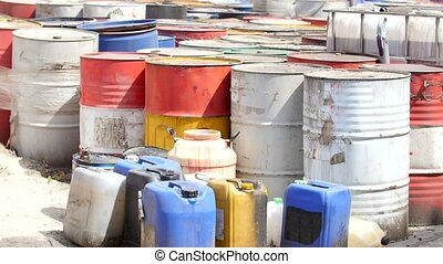 Barrels stand with spent oil products - On the closed...