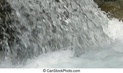 Water in a mountain river in slow motion video. - Beautiful...
