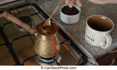 The home coffee in stove. Coffee beans are cooked on the...