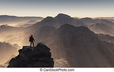 Young man up the mountain admiring the landscape. This is a...