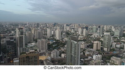 Modern city during cloudy day - Aerial drone view of Bangkok...