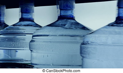 Filled and closed 5 gallon mineral water bottles. - Filled...