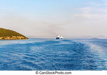 Grimaldi Group eurocargo ship cruising at sunset in Corfu,...