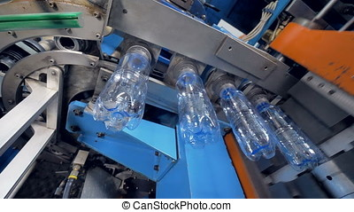 PET bottles transferred from molding chamber and aired...