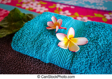 White tiare flowers on a towel - White tiare flowers on a...