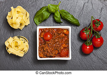 overview of tagliatelle bolognaise with basil