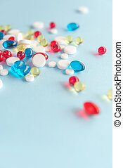 Heap of mixed colorful gel capsules - Colorful capsules...