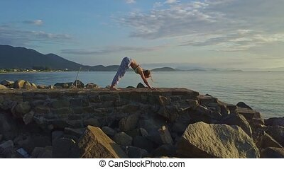 Drone View Girl Does Yoga against Tranquil Sea Hills - drone...