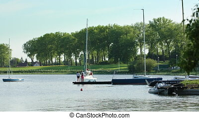 Parked Yachts at a Beautiful Riverbank - Parking yachts and...