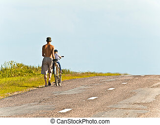 first walks. - father and son on the road