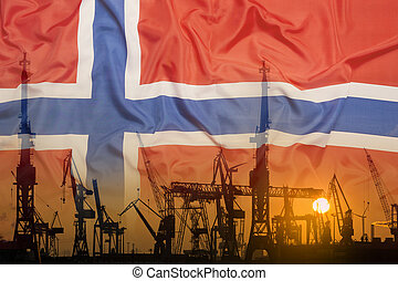 Industrial concept with Norway flag at sunset