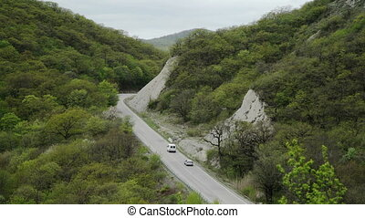Aerial Shot of Cars Moving on Curvy Mountain Road - Aerial...