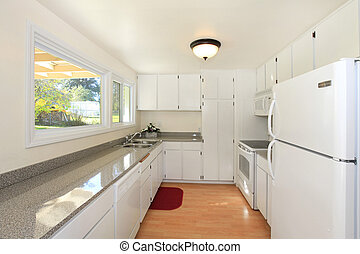 White kitchen - Small house, renovated and empty in...