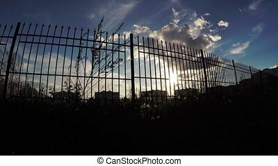 Sun through the fence - Moving along the fence and breaking...