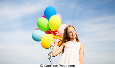 happy girl in sunglasses with air balloons