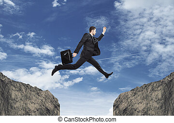 Faith concept - Side view of young businessman jumping over...