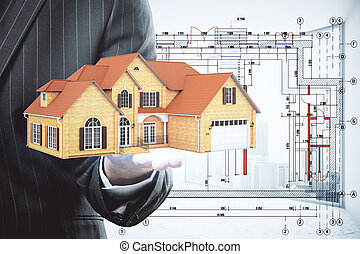 Real estate concept - Businessman holding abstract house...