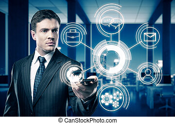 Technology concept - Businessman holding smartphone with...