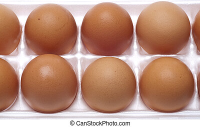 Brown Eggs - Close Up of Brown Eggs in the Carton Food...