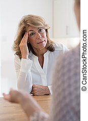 Mature Woman Discussing Problems With Counselor