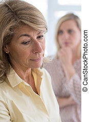 Serious Mature Woman With Adult Daughter At Home