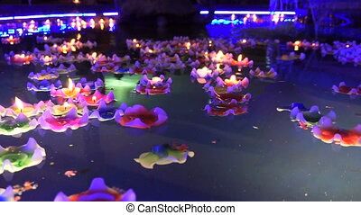 flower-shaped candle burning in the spirit pool