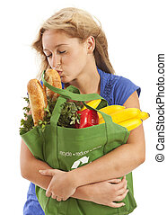 Young woman kissing food