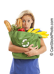 Young woman with healthy food - Humorous portrait of young...