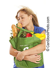 Young woman kissing food - Humorous portrait of young woman...
