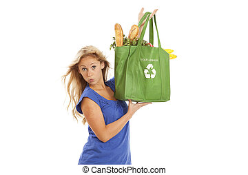 Young woman with reusable bag - Humorous portrait of young...