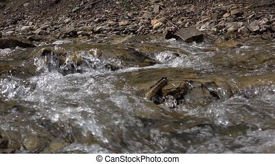 Pure stream of mountain river among stony coasts. Natural...