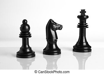Isolated chess pieces in Black and white