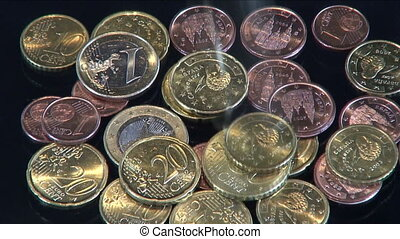 Euro - Coins are tumbling on a desk