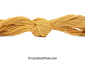 Knot on weaved woollen cloth thread