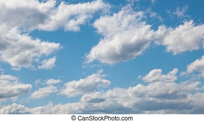 White clouds are formed in the blue sky. Time lapse - White...
