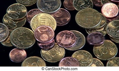 Euro - Coins are tumbling on a desk.