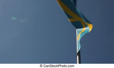 Swedish flag waving against blue sky background