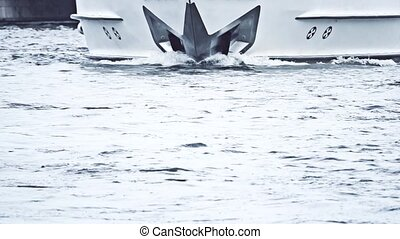 The bow of a moving motor yacht and water surface. Slow...