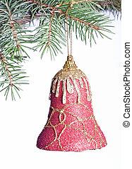 Christmas bell on fir-tree