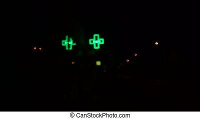 Green neon light. Green cross as symbol of pharmacy - chemist's
