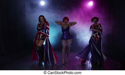 Dance performance female group on stage with lights and...
