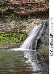 Falls of the Hocking River - A small waterfall spills from a...