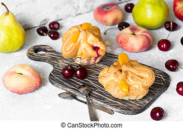 Baskets of puff pastry with fruit on a light background