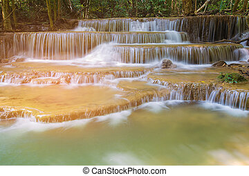 Natural multiple layers stream waterfall in tropical national park of Thailand