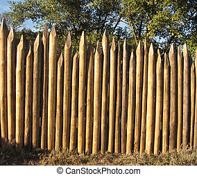 fence; palisade - the high palisade fence of round logs