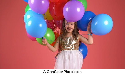 Happiness and joy of a child. little girl laughing and smiling at the camera. slow motion