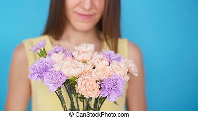 Young woman with a bouquet of flowers